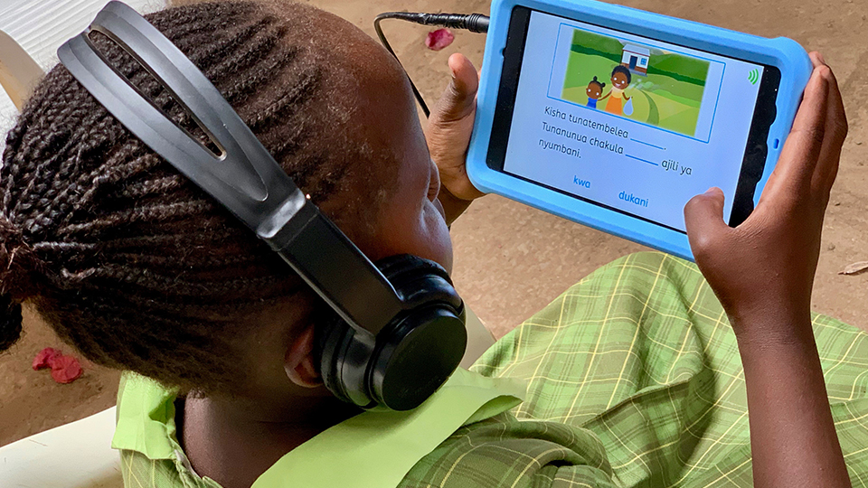 Girl with headphones uses onebillion tablet computer